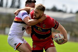 Dewsbury's Tom Garratt looks to offload the ball and set up a Rams attack during last Sunday's Championship clash at home to Bradford Bulls. Picture: Paul Butterfield