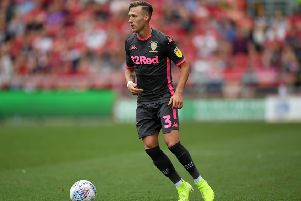 BRISTOL, ENGLAND - AUGUST 04: Barry Douglas of Leeds United on the ball during the Sky Bet Championship match between Bristol City and Leeds United at Ashton Gate on August 04, 2019 in Bristol, England. (Photo by Alex Davidson/Getty Images)