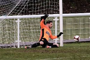Goalkeeper Ryan Musselwhite pulls off a superb penalty-save for Belper. (PHOTO BY: Tim Harrison)