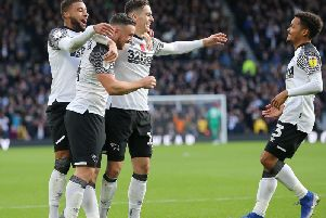 Tom Lawrence (centre) is congratulated after scoring against Middlesbrough. Photo by Jez Tighe.