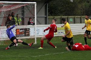 It's 1-0 to Belper as Alex Peterson slots in the first of his two goals.