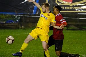Riece Bertram (left) battles for possession at Sheffield on Boxing Day. Photo by Tim Harrison.