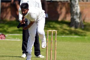 Mohamed Dilshad bowls for Langley Mill against Duffield. Photo by Brian Eyre.