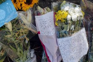 Dozens of floral tributes have been left at the scene.