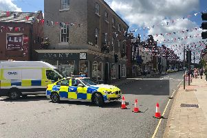 Police have cordoned off Church Street in Ashbourne. Image by Derbyshire Roads Police.