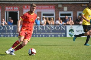 Tom Marshall in action the Robins against Belper. Photo by Danny Draper.
