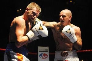 Jeff Thomas, right, pictured during his last pro fight in 2012