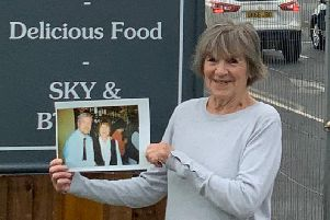 Ann with a picture of late husband Peter