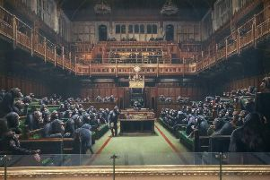 Devolved Parliament by Banksy. Isnt it demeaning to portray primates in an environment usually occupied by the overpaid, expenses-guzzling individuals... one reader asks