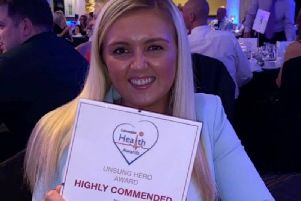 Chloe Doherty, 21, of Staining, is a student nurse aiming to set up a free social service. She is pictured here with her highly commended award for Unsung Hero at the Lancashire Health Awards