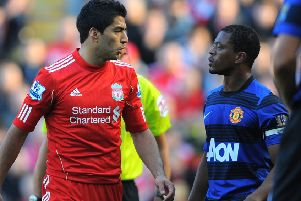 Luis Suarez (left) exchanges words with Patrice Evra during the Premier League clash between Liverpool and Manchester United at Anfield in October 2011 (photo: Getty Images)