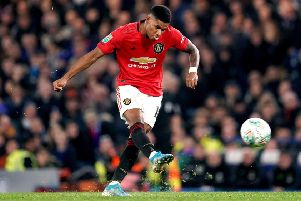 Marcus Rashford scores the winner against Chelsea and United's reward is a home tie against Colchester