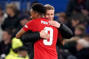 Manchester United manager Ole Gunnar Solskjaer (right) hugs Anthony Martial at the end of the Carabao Cup victory against Chelsea