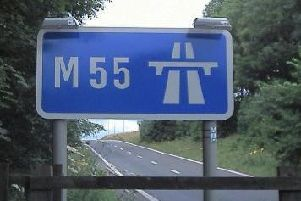 The car was pulled over on the M55