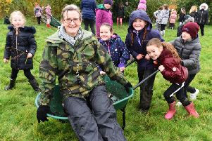 Teacher Kate Steventon is pushed to the woods by pupils at Northfold Community Primary school.