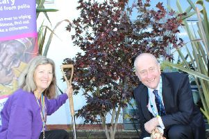 Angela Butcher, president of Blackpool Palatine Rotary and Pearse Butler, Chairman of Blackpool Teaching Hospitals NHS Foundation Trust, at the planting of the Acer tree to mark the fight against polio