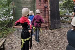 Pupils from Aspire Academy tackle the climbing wall during a trip to the Lakes