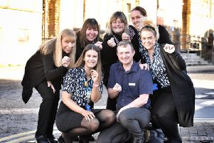 Adelaide Street Family Practice staff with their badges