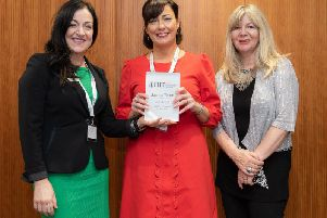 Joanna Taplin (centre) receives her 2019 FHT Complementary Therapist of the Year'award from FHT Vice President and Excellence Awards judge, Maria Mason (left) and BBC 2 radio presenter Janey Lee Grace (right)