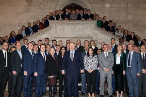 Prime Minister Boris Johnson alongside the newly elected Conservative MPs