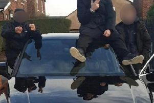 Daft yobs in burglary gang posted picture of themselves posing with this stolen car on Facebook