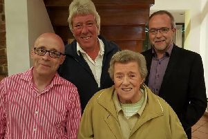 Phyllis Hutton, of St Annes, with her sons Gordon, Alan and Iain