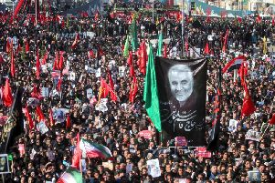 Mourners attend a funeral ceremony for Iranian Gen. Qassem Soleimani and his comrades, who were killed in Iraq in a U.S. drone strike on Friday, in the city of Kerman, Iran, Tuesday, Jan. 7, 2020.