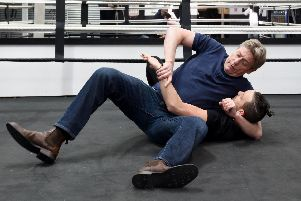 WWE star William Regal shows gym boss Ryan Davies a few moves