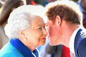 Queen Elizabeth II being greeted by her grandson the Duke of Sussex