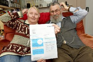Tom and Margaret Anne McMellon with their bill for 1p from British Gas. Pictures: Daniel Martino