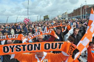 Blackpool fans protest against the Oystons on a parade through the town to the ground