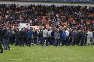 Blackpool fans stage a protest and pitch invasion last May