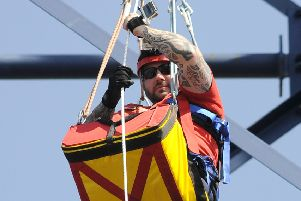 Sgt Rick Clement abseils down the Big One