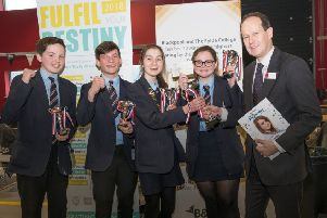 The finals of the Young Engineers competition at Blackpool and the Fylde College. Winners St Bede's receive their prize from Matt Lambert of Cuadrilla.