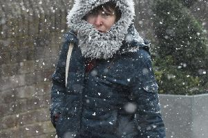A woman caught in a snow shower on Saturday'Photo: PA