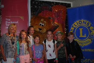 Fleetwood and Cleveleys Lions president Margaret Purcell with youngsters from Chernobyl at the Tower Circus.