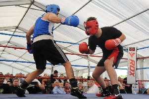A white-collar boxing evening was organised at Kirkham and Wesham Cricket Club to raise funds for three year-old Jorgie Rae Griffiths, who is suffering from neuroblastoma. Action from the bout featuring Andy Davis (left) against Zach Sidani .  PIC BY ROB LOCK 28-7-2018