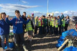 Volunteers from the Rossall Beach Residents and Community Group tackling the rubbish on Rossall Beach. (s)