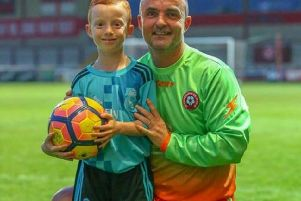 Oliver Hartley, seven, with his dad Michael