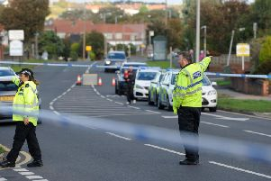 Officers at the scene of the accident yesterday