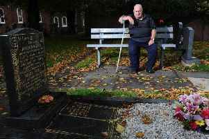 Richard Higham beside the grave at Freckleton Parish Church.