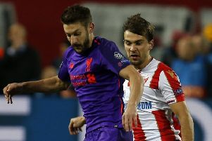 Adam Lallana battles with Red Star's Filip Stojkovic in the Champions League Group C match in Belgrade