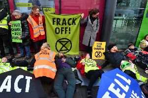 Activists from Extinction Rebellion stage an anti-fracking protest outside the Department for Business, Energy and Industrial Strategy in Westminster, London