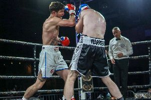 Brian Rose on the offensive against Alistair Warren on his return to the ring. Picture: Chris Roberts for MTK Global