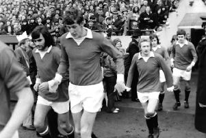 George Best (left) runs out at Deepdale in February 1972, followed by Alan Gowling and Denis Law