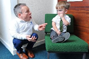Actor Warwick Davis pays a visit to Strike Lane Primary School in Freckleton.  He is pictured with pupil Lorcan Woodman.