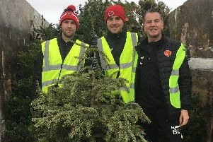 Fleetwood Town Academy staff on their Christmas tree collection round.