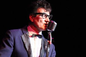 Marc Robinson as Buddy Holly