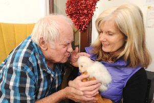 Karen Mankowska takes her owls to residents at The Knights Care Home.  She is pictured with Brian Rolands.