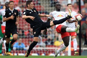 RB Leipzig's Jean-Kevin Augustin (right) and Sevilla's Sergio Escudero battle for the ball during the Emirates Cup match at the Emirates Stadium